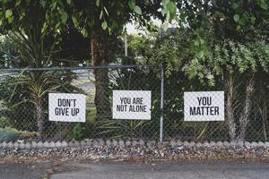 "abuse and trauma victims need positive support and care. Three signs say ""don't give up"" and other positive messages. Our mental health CE courses give you insight into people suffering from abuse and trauma."
